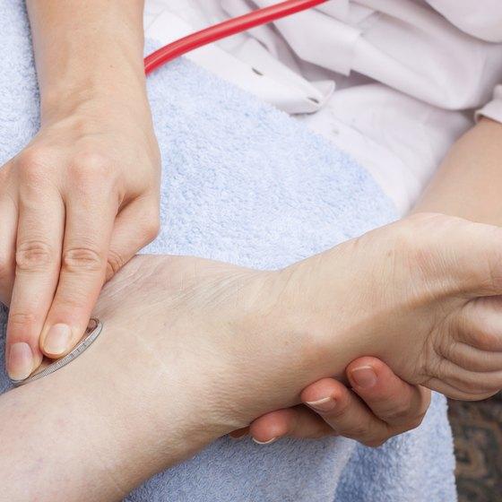 Doctor examining patients foot