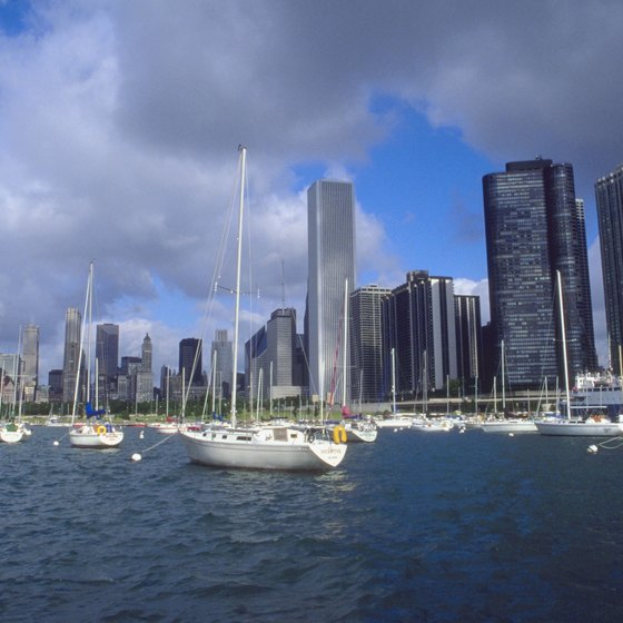 The Chicago skyline frames sailboats moored in Lake Michigan.