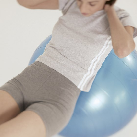 Crunches on a stability ball can help tone the muscles under your layers of fat.