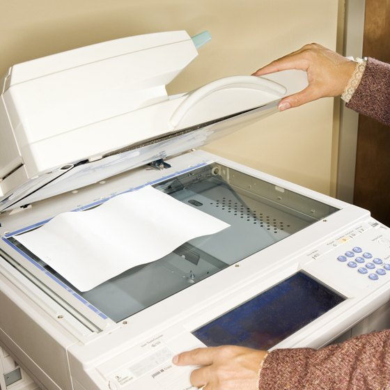 Photocopier drums are sensitive to light; handle carefully when replacing.