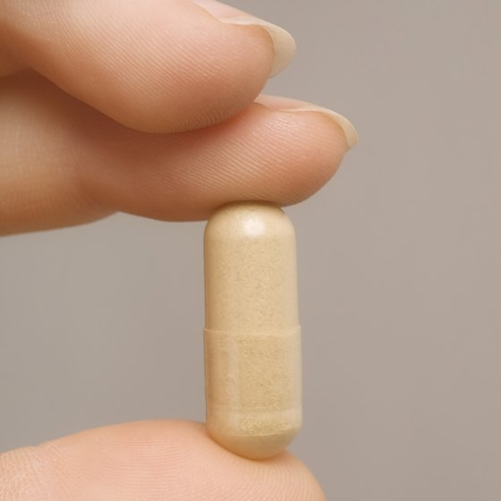 A woman is holding a fiber supplement.