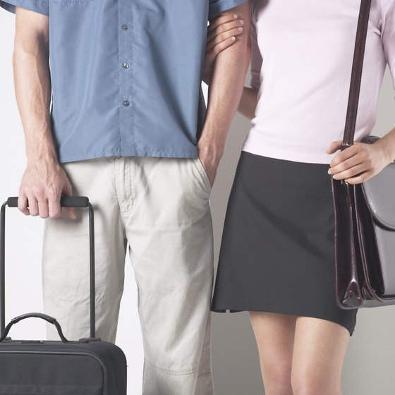 Small rolling suitcases and shoulder bags typically fit the size restrictions for carry-on luggage on United Airlines.