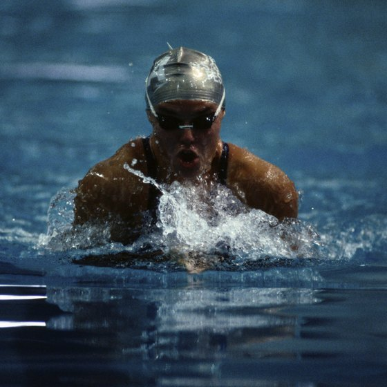 Slow down with drills to achieve a faster pace in the breaststroke.