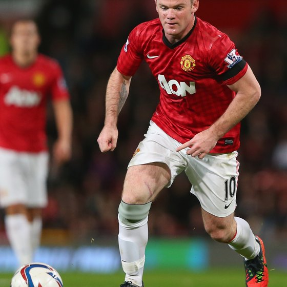 Wayne Rooney of Manchester United moves powerfully down the field.