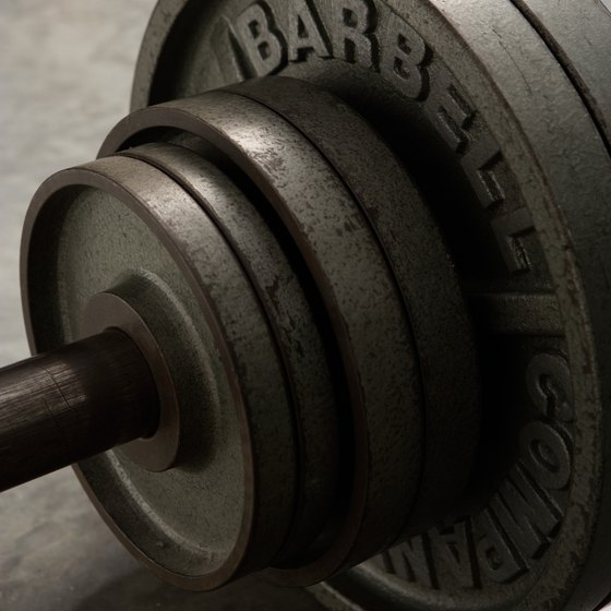 Hold barbell plates when you exercise for added resistance.