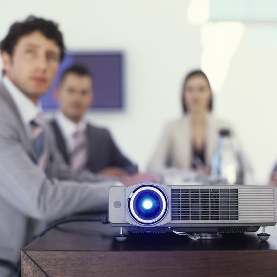 This video projector rests in a risky edge-of-table location.