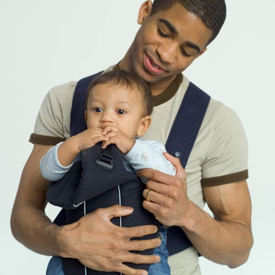 Use a baby carrier on the plane to keep baby close.