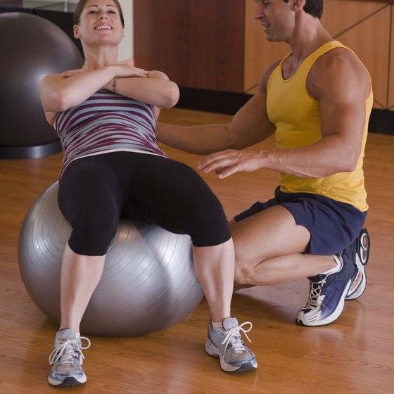 Crunches and fitness ball work can help tighten stomach muscles.