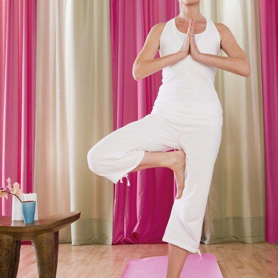 Demonstrate basic yoga exercises.