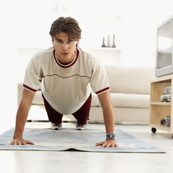Pushups provide an effective way to tone your chest at home.
