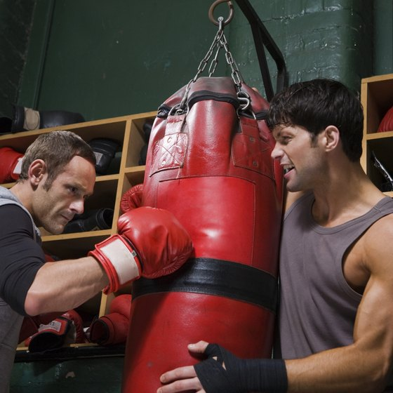 Use a partner to keep your punching bag in a fixed position.