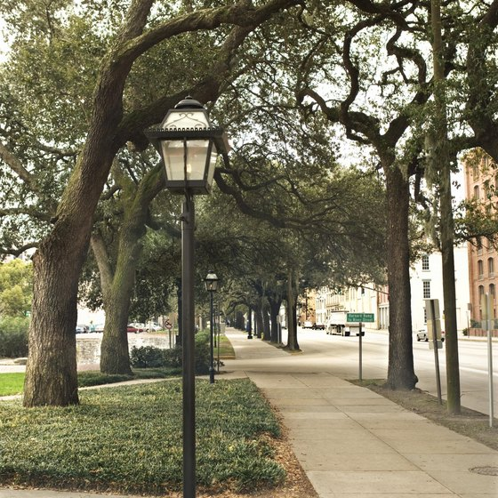 Parks and plazas lit by gas lamps are common in the Historic District of Savannah.