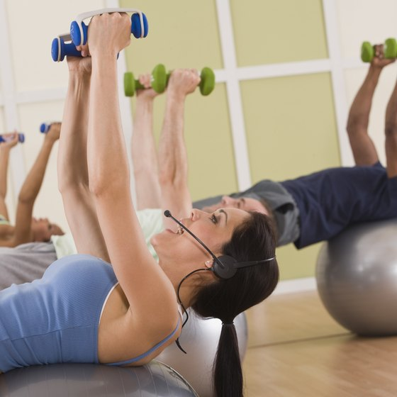 Work out on a regular basis by teaching group fitness classes.