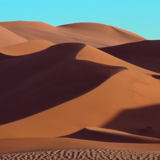 The miles of loose sand particles in the Sahara Desert are easily airborne during fierce winds.