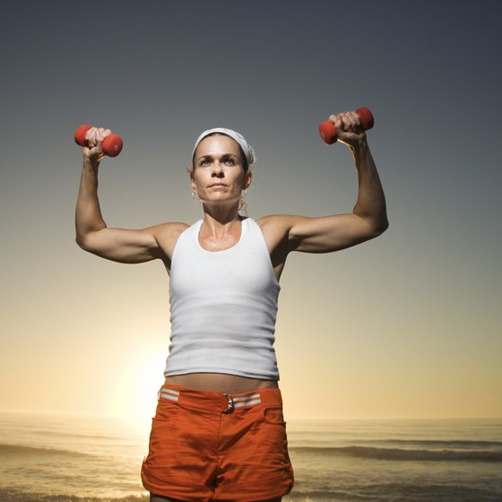 You can use dumbbells to complete a standing overhead shoulder press.