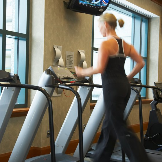 Jogging on a treadmill helps you improve your physical fitness.