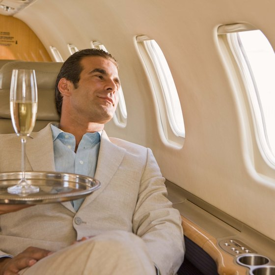 Alcohol dehydrates the body, worsening altitude sickness symptoms during flights.