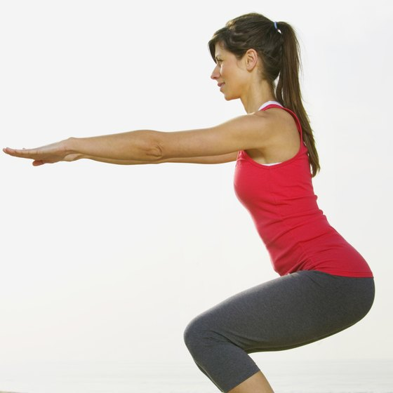Lifting your arms to the front improves balance during the air squat.