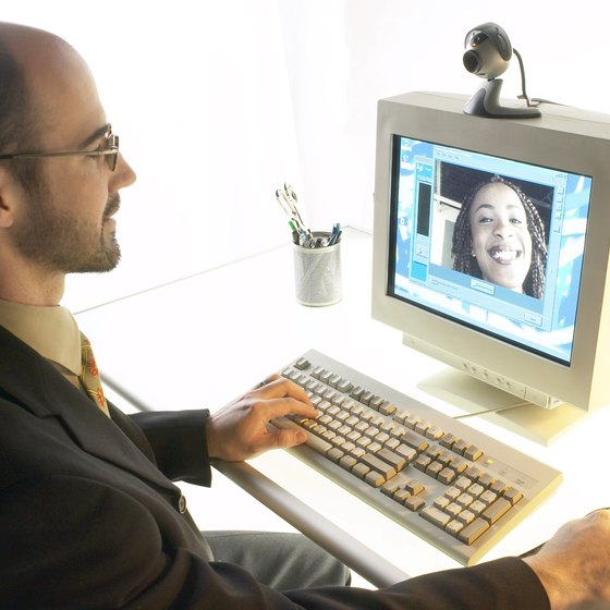 With a webcam and an Internet connection co-workers can connect over long distances.