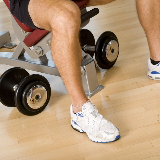 Circuit training with weights can help reduce your leg size.