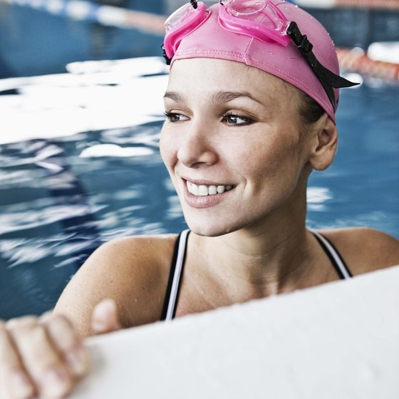 Wear goggles over or under your swim cap.