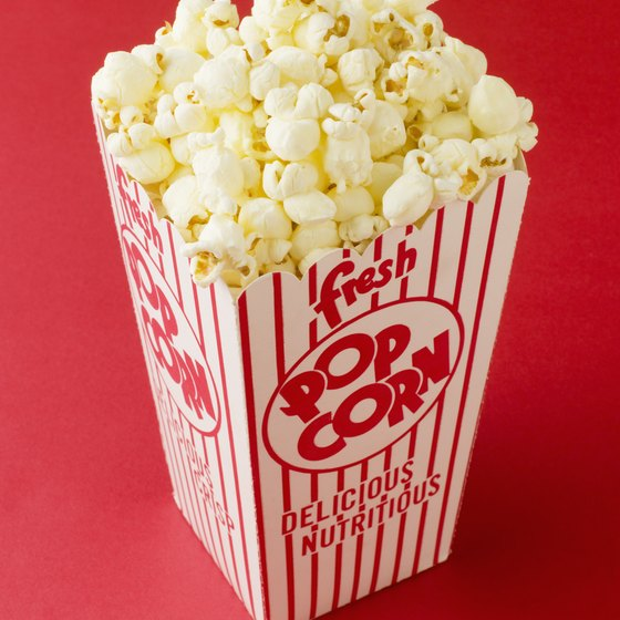 Add popcorn and beverages to a movie night to make it more fun.