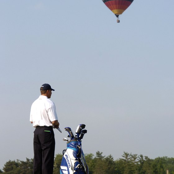A hot air balloon displaying an ad in the sky.