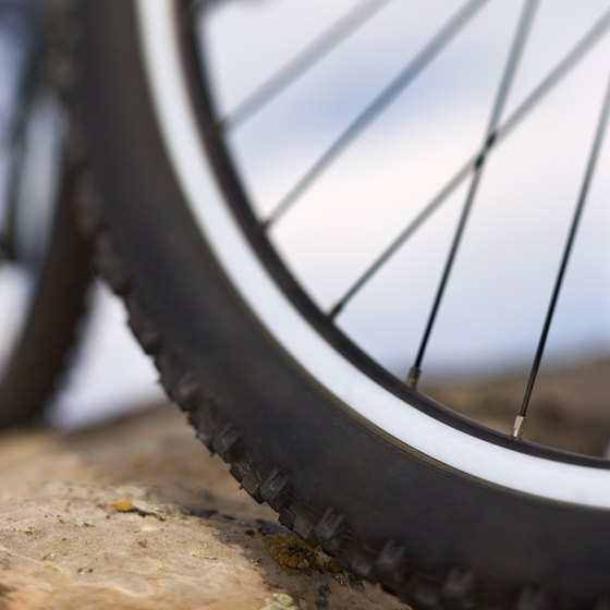 Knobby mountain bike tires grip well on dirt and rock surfaces.