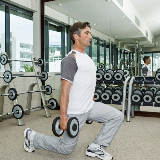 Lunges with weights work on thighs, abs and grip strength.