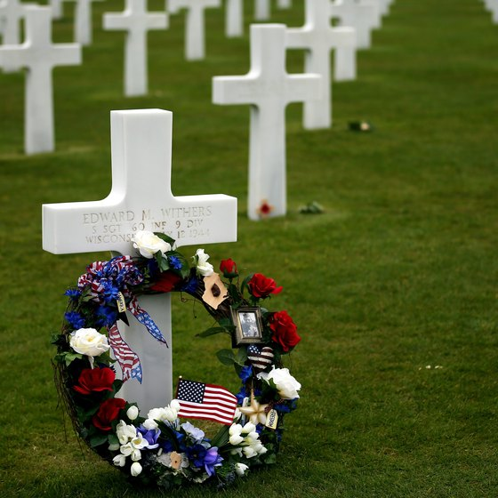 A wreath honors one of the fallen at the Normandy American Cemetery and Memorial above Omaha Beach.