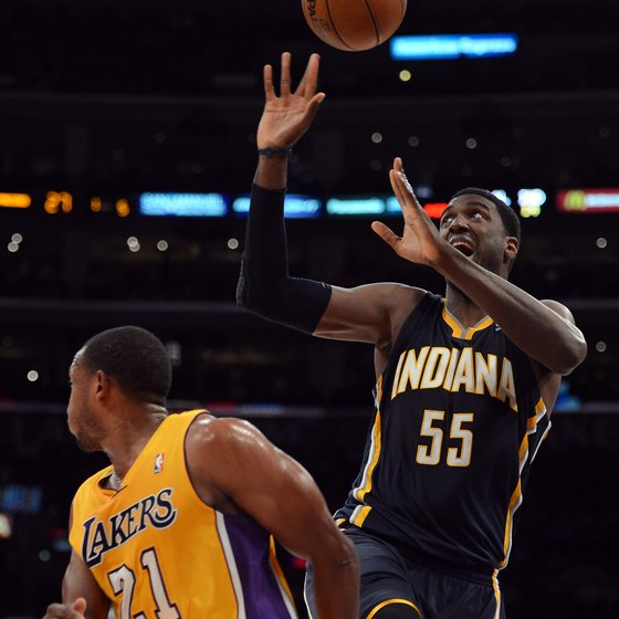 Trap bar deadlifts help Pacer Roy Hibbert, right, improve his rebounding strength.