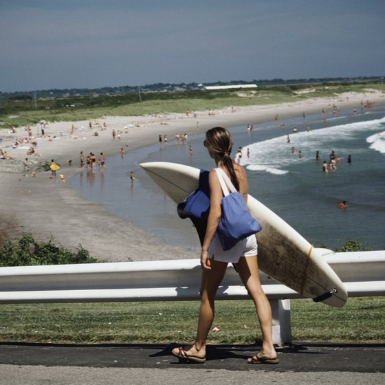 Surfers enjoy Rhode Island beaches.