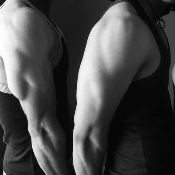 Triceps kickbacks isolate the back of the upper arm.