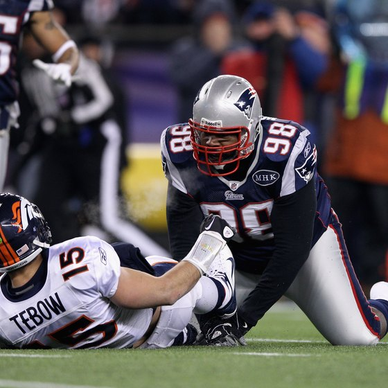New England's Gerard Warren sacks then Denver quarterback Tim Tebow in a 2012 NFL playoff game.