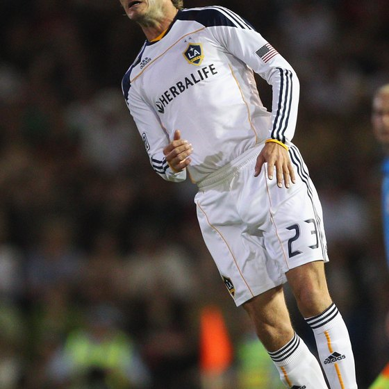 David Beckham of the L.A. Galaxy heads the ball.
