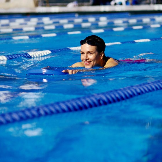 Adding kicking drills to your swim workout strengthens and tones leg muscles.