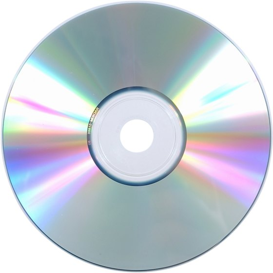 A media file stored on a CD or DVD can be played through a computer and a projector.
