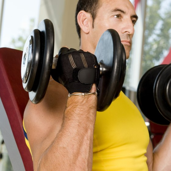 Doing curls on an inclined bench increases the range of motion.