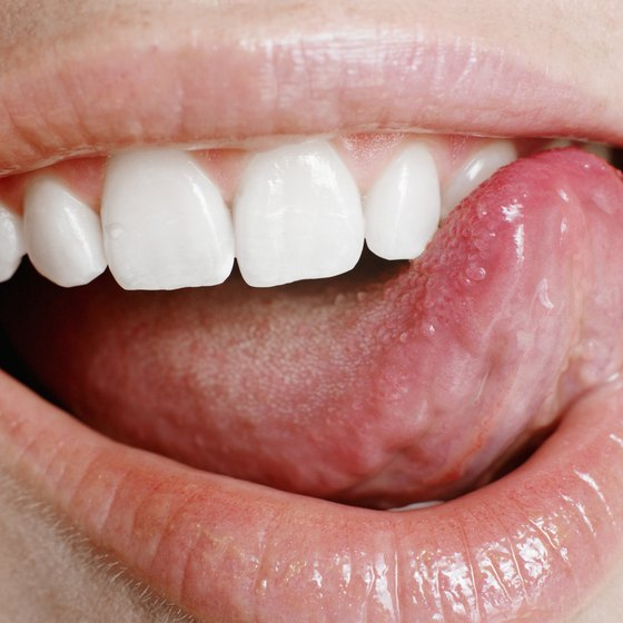 Woman touching teeth with tounge