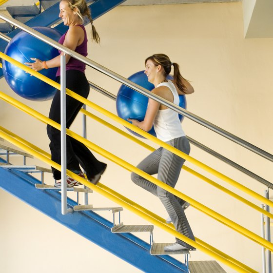 Walking up stairs with balls or weights will increase workout intensity.