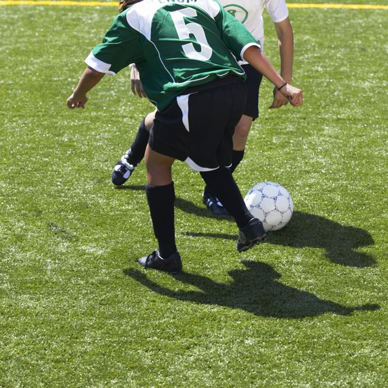 Keep the ball close to your feet to dribble past opposing players.