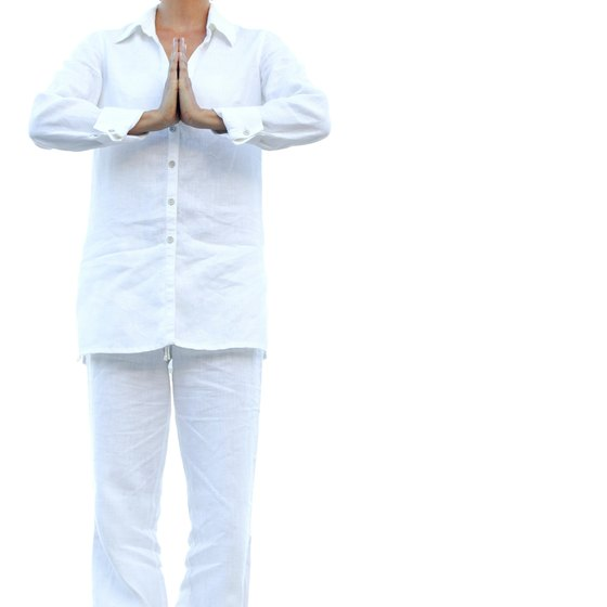Use the prayer position to perform a Chi Gong breathing exercise.