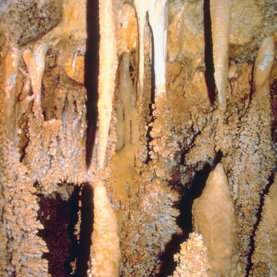 Cave formations grow as the result of calcite deposits.