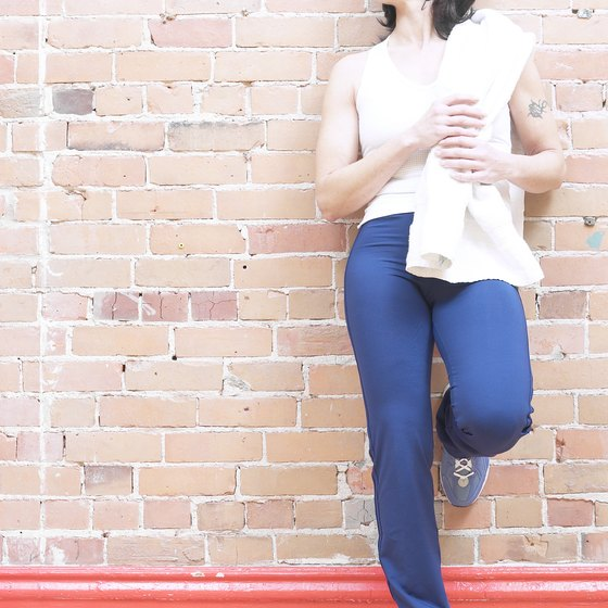 Place your foot on the wall and tighten your buttocks to stretch quads.