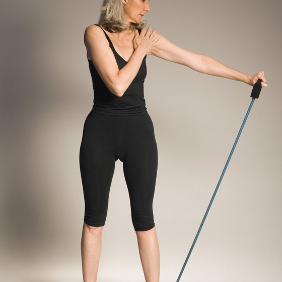 Resistance bands assist shoulder stretching.