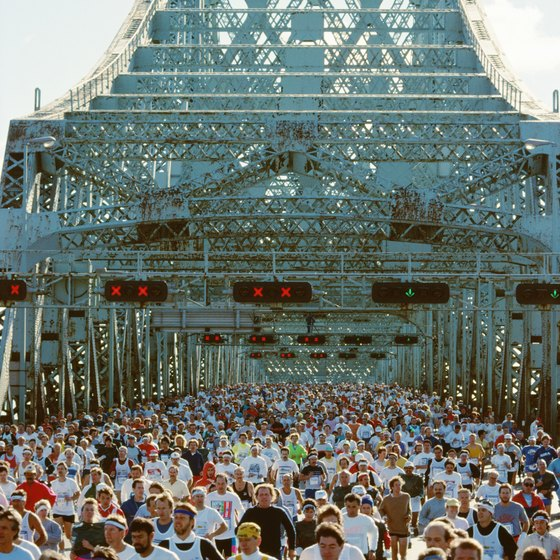 A half marathon is a good step to take before running in a marathon, but is not absolutely necessary.
