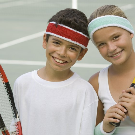 Kids participate in a variety of sports including tennis, swimming or running.