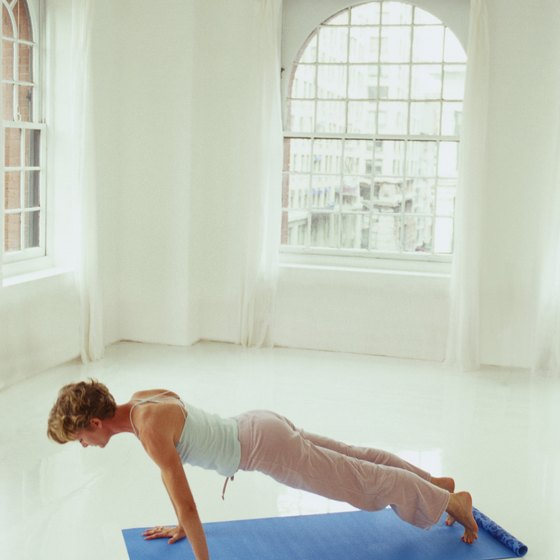Plank pose can help to strengthen your abs.