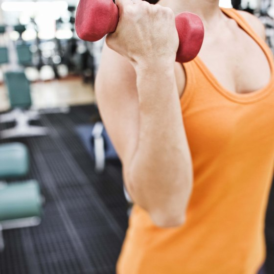 In biceps curls, the triceps slow down the movement at the end of the curl.