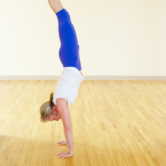 You need to feel balanced in a handstand position before doing the forward roll.